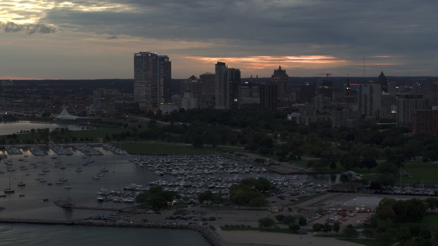 5.7K stock footage aerial video stationary view of the city's skyline, seen from the marina at twilight, Downtown Milwaukee, Wisconsin Aerial Stock Footage | DX0002_155_026