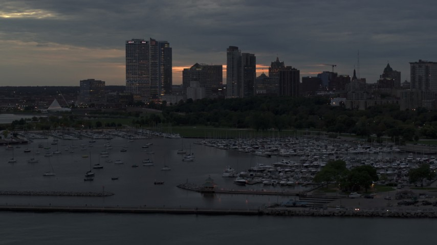 5.7K stock footage aerial video of ascending by the marina with a view of the city's skyline at twilight, Downtown Milwaukee, Wisconsin Aerial Stock Footage | DX0002_155_029