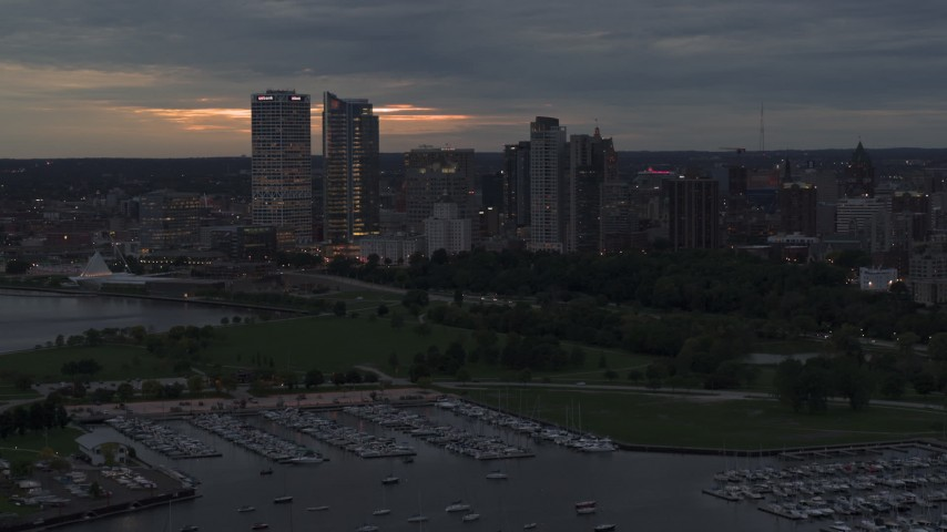 5.7K stock footage aerial video flyby the marina with a view of the city's skyline at twilight, Downtown Milwaukee, Wisconsin Aerial Stock Footage | DX0002_155_031