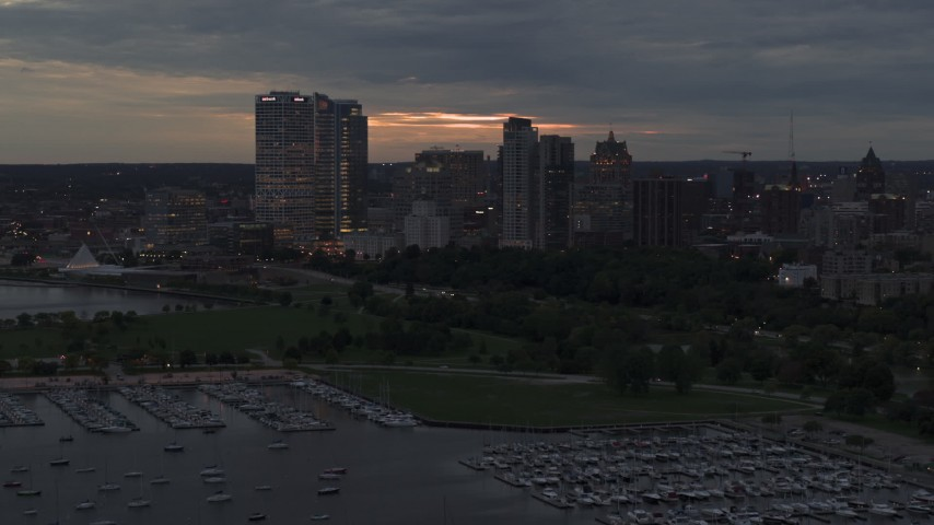5.7K stock footage aerial video flyby and away from the city's skyline at twilight, Downtown Milwaukee, Wisconsin Aerial Stock Footage | DX0002_155_033