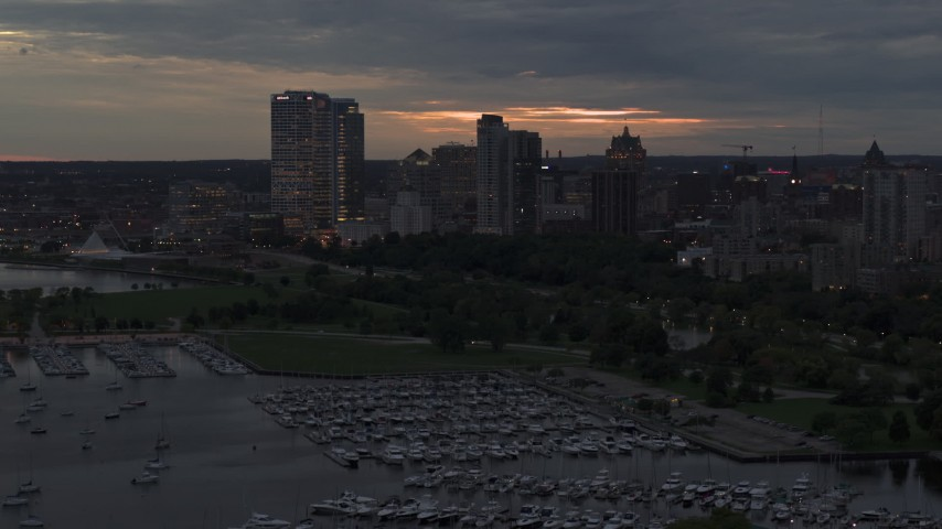 5.7K stock footage aerial video pass and fly away from the city's skyline at twilight, Downtown Milwaukee, Wisconsin Aerial Stock Footage | DX0002_155_034