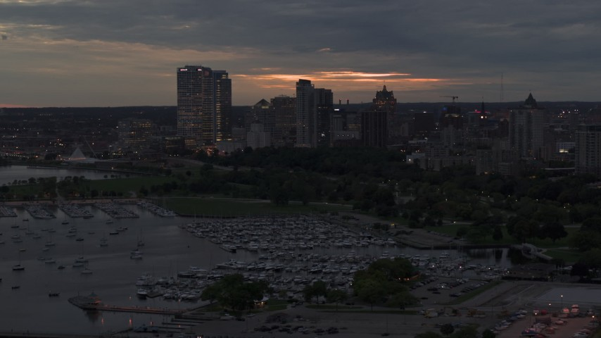 5.7K stock footage aerial video flyby marina and the city's skyline at twilight, Downtown Milwaukee, Wisconsin Aerial Stock Footage | DX0002_155_035