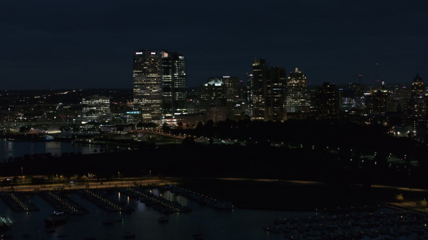 5.7K stock footage aerial video ascend over the marina with a view of the city's skyline at night, Downtown Milwaukee, Wisconsin Aerial Stock Footage | DX0002_155_038