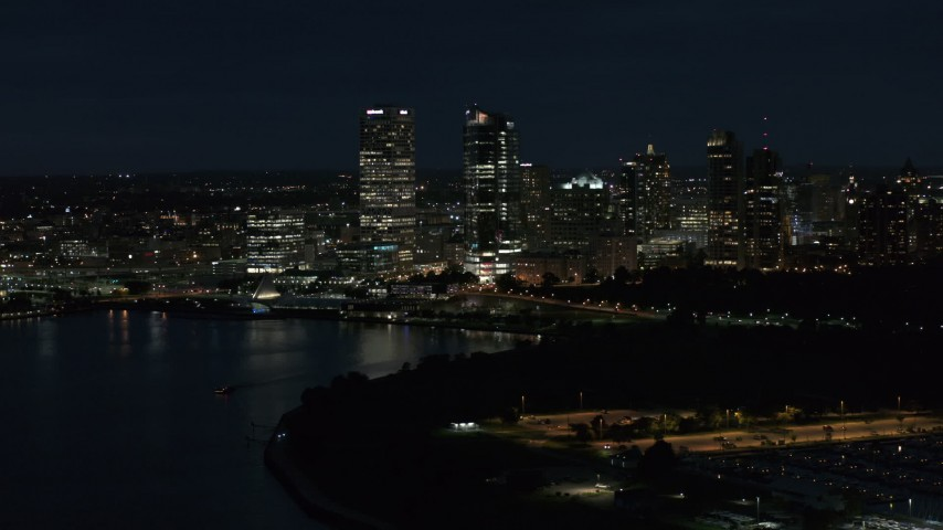 5.7K stock footage aerial video of a view of the city's skyline from the marina at night, Downtown Milwaukee, Wisconsin Aerial Stock Footage | DX0002_155_039