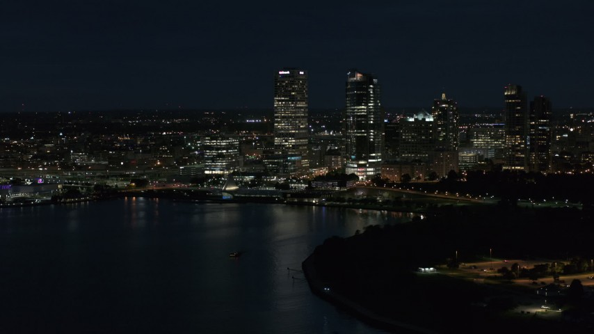 5.7K stock footage aerial video of a view of the city's skyline while flying near the marina at night, Downtown Milwaukee, Wisconsin Aerial Stock Footage | DX0002_155_040