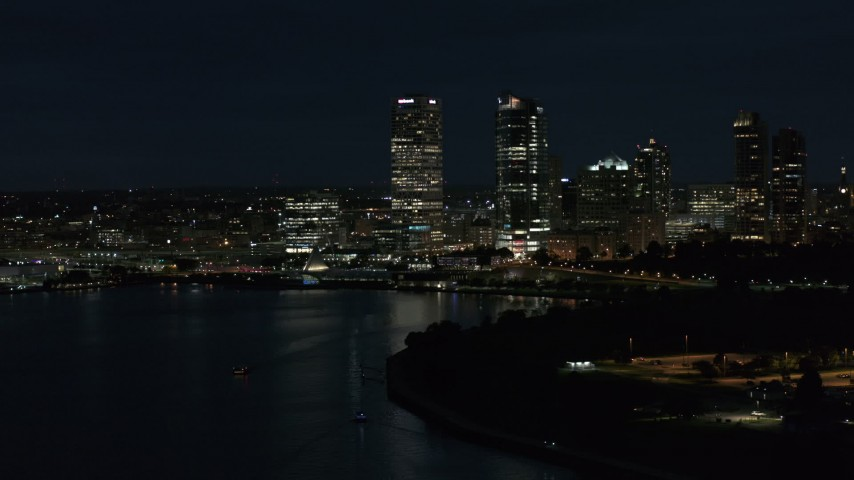5.7K stock footage aerial video of the city's skyline while flying near the marina at night, Downtown Milwaukee, Wisconsin Aerial Stock Footage | DX0002_155_041