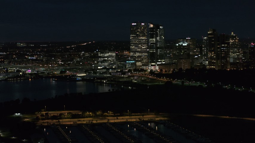 5.7K stock footage aerial video fly above the marina while focused on the city's skyline at night, Downtown Milwaukee, Wisconsin Aerial Stock Footage | DX0002_155_043