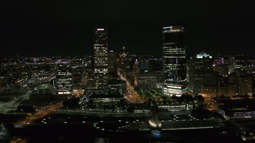 5.7K stock footage aerial video of flying by tall skyscrapers at night, Downtown Milwaukee, Wisconsin Aerial Stock Footage | DX0002_157_002