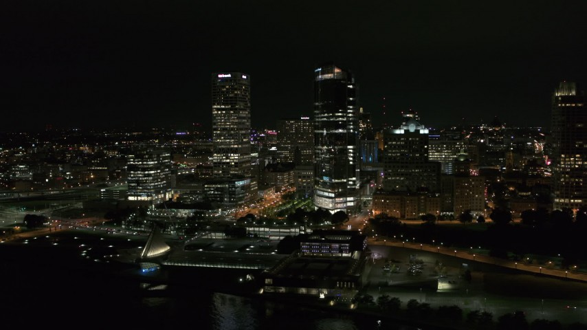 5.7K stock footage aerial video of passing by tall skyscrapers at night, Downtown Milwaukee, Wisconsin Aerial Stock Footage | DX0002_157_003