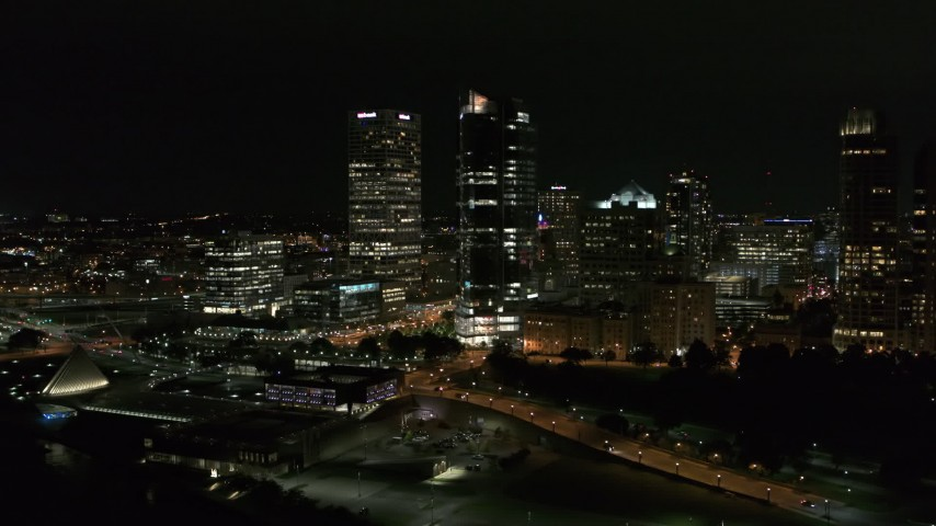 5.7K stock footage aerial video of flying past tall skyscrapers at night, Downtown Milwaukee, Wisconsin Aerial Stock Footage | DX0002_157_004