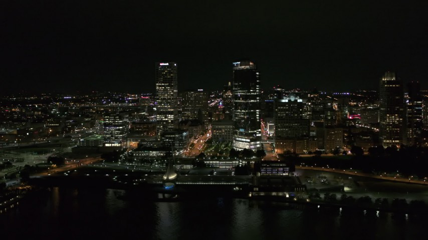 5.7K stock footage aerial video of towering skyscrapers near the shoreline at night, Downtown Milwaukee, Wisconsin Aerial Stock Footage | DX0002_157_007