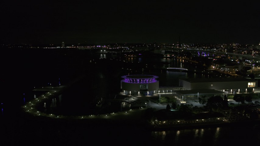 5.7K stock footage aerial video fly away from Discovery World museum at night, Downtown Milwaukee, Wisconsin Aerial Stock Footage | DX0002_157_011