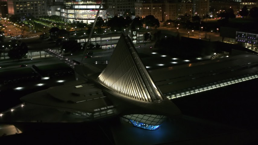 5.7K stock footage aerial video orbit and fly away from the lakefront museum at night, Downtown Milwaukee, Wisconsin Aerial Stock Footage | DX0002_157_018