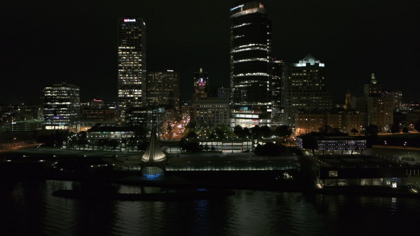 5.7K stock footage aerial video fly away from the lakefront museum near skyscrapers at night, Downtown Milwaukee, Wisconsin Aerial Stock Footage | DX0002_157_020