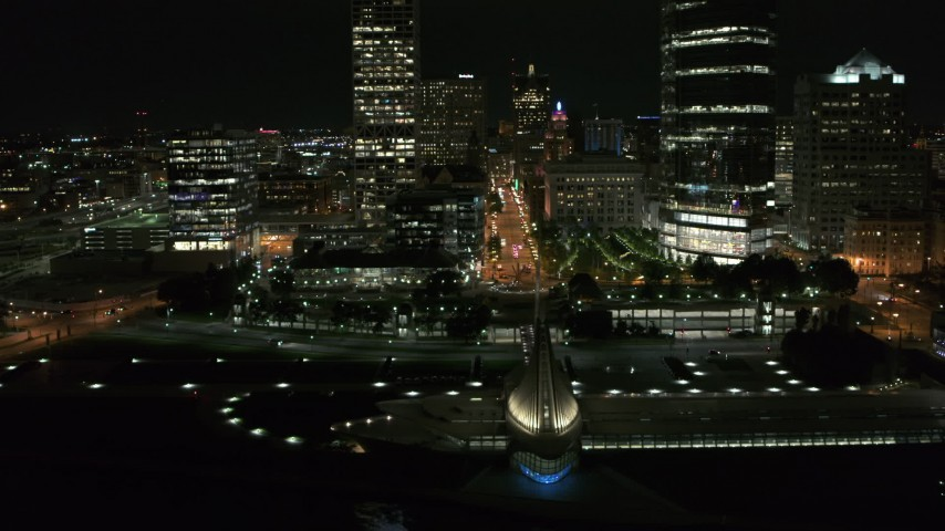 5.7K stock footage aerial video ascend over museum for view of Wisconsin Ave at night, Downtown Milwaukee, Wisconsin Aerial Stock Footage | DX0002_157_022