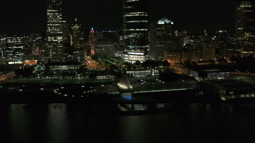 5.7K stock footage aerial video a stationary view of the lakefront museum at night, Downtown Milwaukee, Wisconsin Aerial Stock Footage | DX0002_157_023