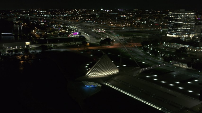 5.7K stock footage aerial video orbit lakefront museum rooftop at night, Downtown Milwaukee, Wisconsin Aerial Stock Footage | DX0002_157_027