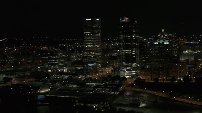 5.7K stock footage aerial video fly away from a pair of towering skyscrapers at night, Downtown Milwaukee, Wisconsin Aerial Stock Footage | DX0002_157_038