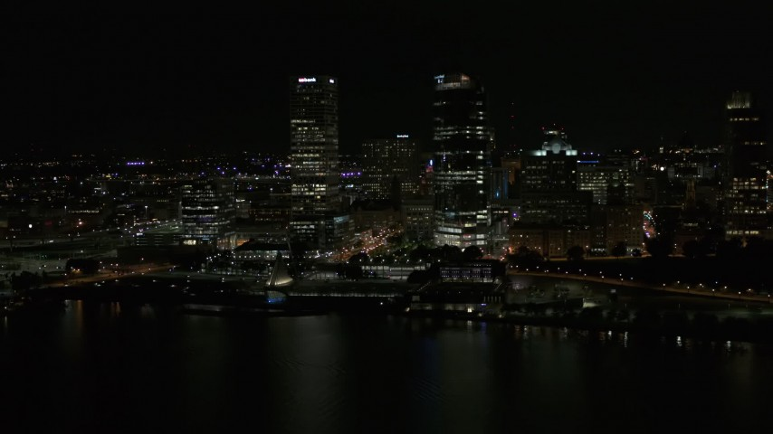 5.7K stock footage aerial video a pair of towering skyscrapers seen from the lake at night, Downtown Milwaukee, Wisconsin Aerial Stock Footage | DX0002_157_039