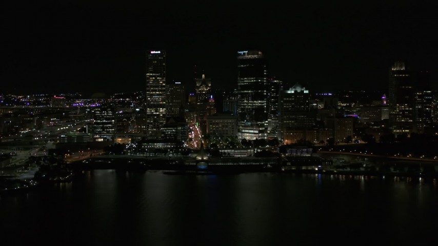 5.7K stock footage aerial video of towering skyscrapers seen from the lake at night, Downtown Milwaukee, Wisconsin Aerial Stock Footage | DX0002_157_040