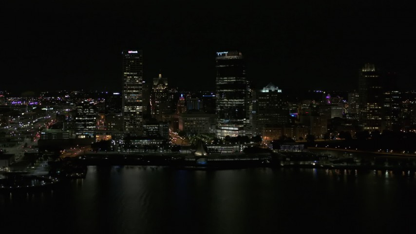 5.7K stock footage aerial video view of towering skyscrapers seen from the lake at night, Downtown Milwaukee, Wisconsin Aerial Stock Footage | DX0002_157_041