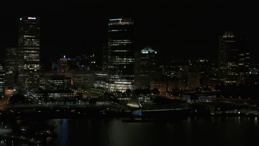 5.7K stock footage aerial video approach skyscraper and museum from Lake Michigan at night, Downtown Milwaukee, Wisconsin Aerial Stock Footage | DX0002_157_043