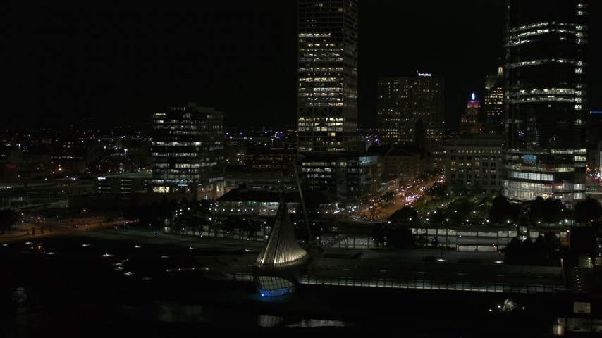 5.7K stock footage aerial video orbit museum near skyscrapers at night, Downtown Milwaukee, Wisconsin Aerial Stock Footage | DX0002_157_045