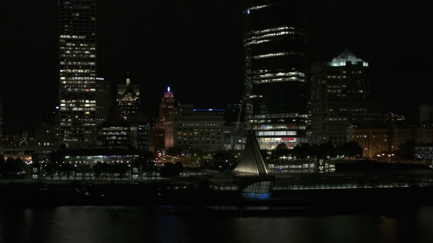 5.7K stock footage aerial video slow orbit of the lakefront museum near skyscrapers at night, Downtown Milwaukee, Wisconsin Aerial Stock Footage | DX0002_157_048