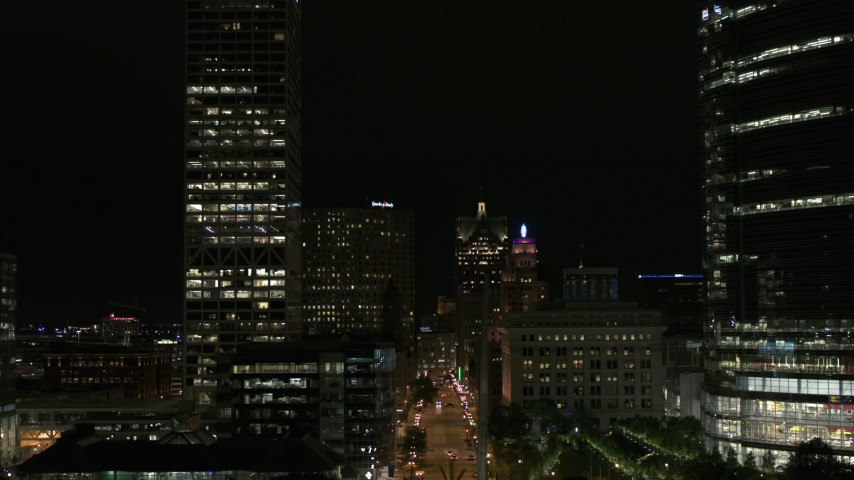 5.7K stock footage aerial video fly over museum near skyscrapers, reveal city street at night, Downtown Milwaukee, Wisconsin Aerial Stock Footage | DX0002_157_053