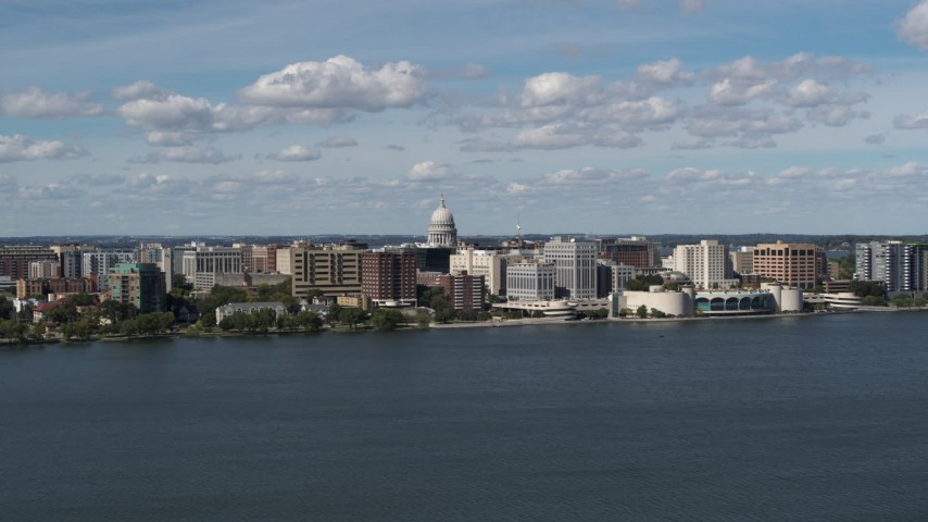 5.7K stock footage aerial video slowly fly away from lakefront city buildings in Madison, Wisconsin Aerial Stock Footage | DX0002_158_005