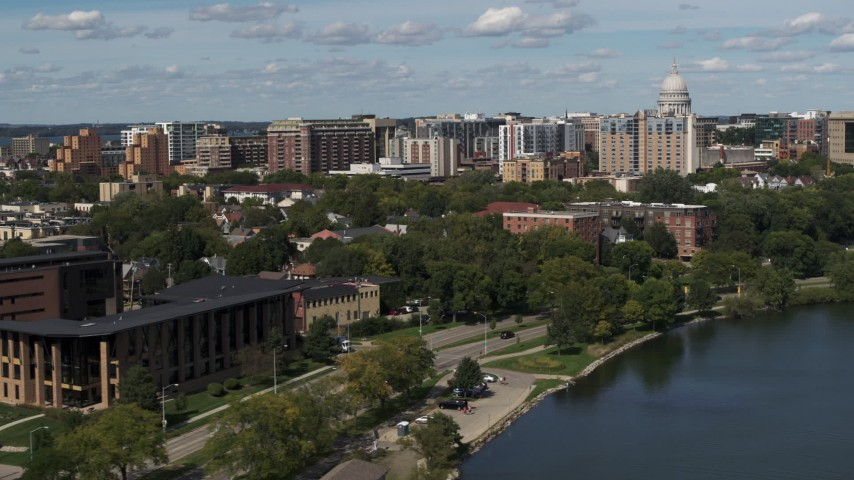 5.7K stock footage aerial video of apartment buildings near the capitol dome in Madison, Wisconsin Aerial Stock Footage | DX0002_158_010
