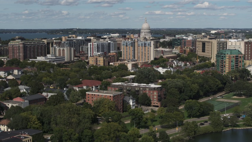5.7K stock footage aerial video approach apartment buildings and capitol dome in Madison, Wisconsin Aerial Stock Footage | DX0002_158_011