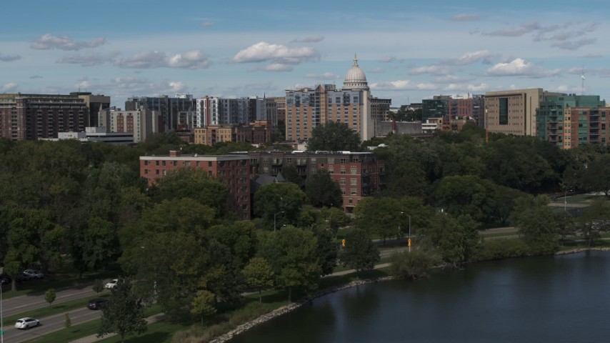 5.7K stock footage aerial video brick apartment buildings by the water in Madison, Wisconsin Aerial Stock Footage DX0002_158_012 | Axiom Images
