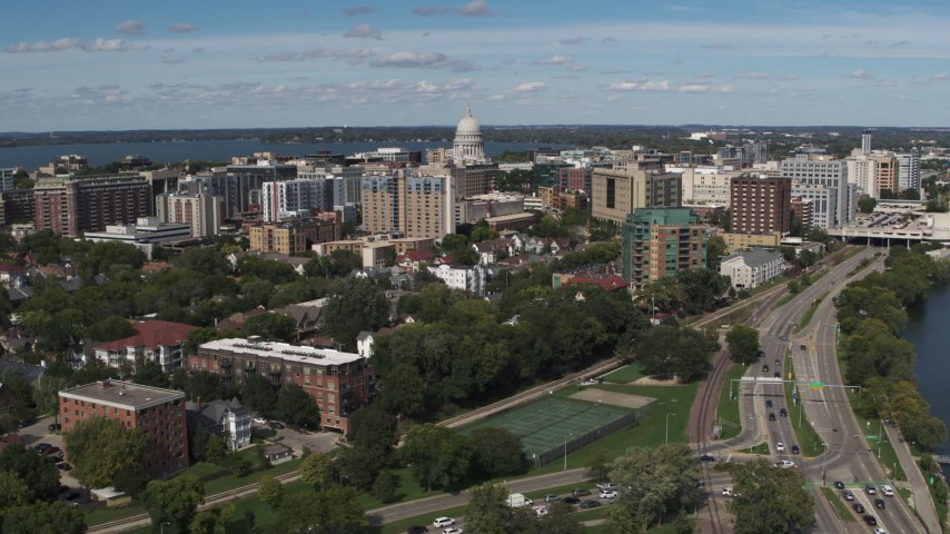 5.7K stock footage aerial video reverse view of apartment complexes near the capitol dome in Madison, Wisconsin Aerial Stock Footage | DX0002_158_017