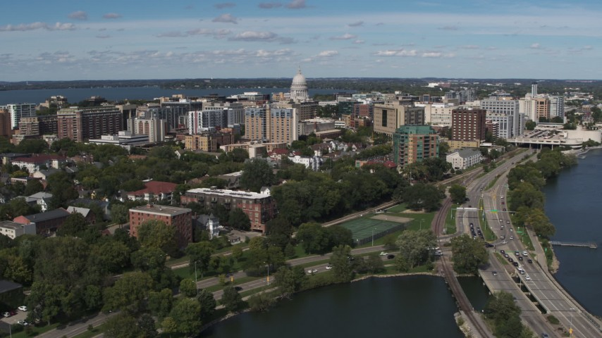 5.7K stock footage aerial video of passing apartment complexes around the capitol dome in Madison, Wisconsin Aerial Stock Footage | DX0002_158_018