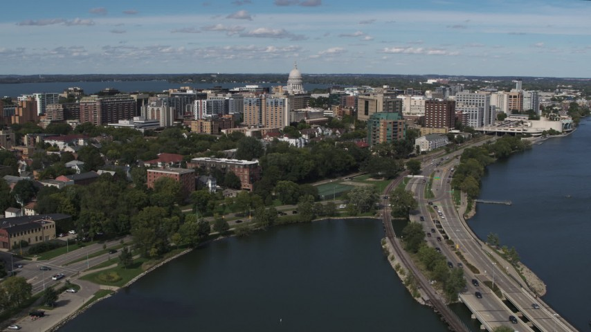 5.7K stock footage aerial video flyby and fly away from apartment complexes around the capitol dome in Madison, Wisconsin Aerial Stock Footage | DX0002_158_019
