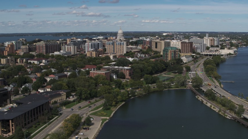 5.7K stock footage aerial video flyby and fly and then approach apartment complexes around the capitol dome in Madison, Wisconsin Aerial Stock Footage | DX0002_158_020