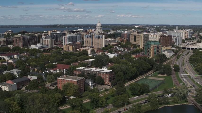 5.7K stock footage aerial video an approach to apartment complexes around the capitol dome in Madison, Wisconsin Aerial Stock Footage | DX0002_158_021