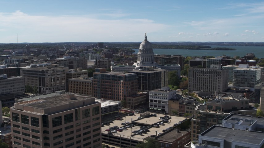 5.7K stock footage aerial video of the capitol dome surrounded by office buildings, Madison, Wisconsin Aerial Stock Footage | DX0002_158_023