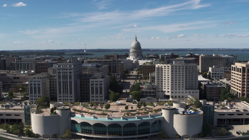 5.7K stock footage aerial video of the capitol dome and office buildings, reveal convention center, Madison, Wisconsin Aerial Stock Footage | DX0002_158_025