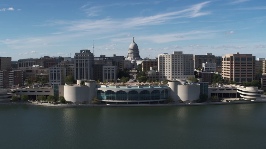 5.7K stock footage aerial video reverse view of capitol dome, office buildings, and convention center, Madison, Wisconsin Aerial Stock Footage DX0002_158_026 | Axiom Images