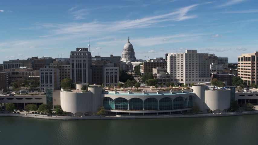 5.7K stock footage aerial video approach capitol dome, office buildings, and convention center, Madison, Wisconsin Aerial Stock Footage | DX0002_158_027