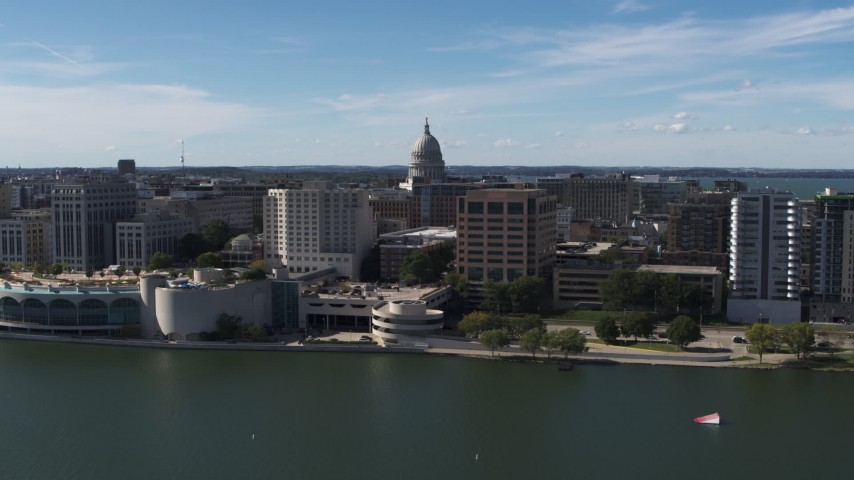 5.7K stock footage aerial video passing convention center with view of capitol dome, office buildings, Madison, Wisconsin Aerial Stock Footage | DX0002_158_030