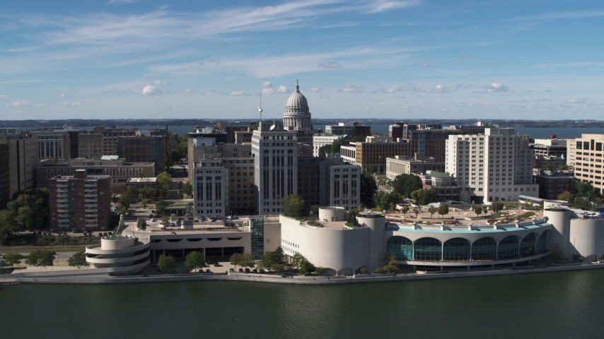 5.7K stock footage aerial video flyby the convention center with view of capitol dome, office buildings, Madison, Wisconsin Aerial Stock Footage | DX0002_158_032