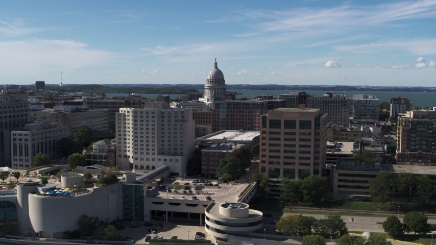 5.7K stock footage aerial video flyby the convention center, ascend for view of capitol dome, office buildings, Madison, Wisconsin Aerial Stock Footage | DX0002_158_033