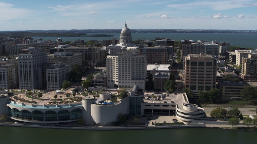 5.7K stock footage aerial video of the capitol dome and office buildings, seen while from the convention center, Madison, Wisconsin Aerial Stock Footage | DX0002_158_037