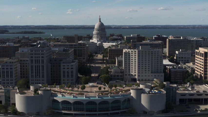5.7K stock footage aerial video of the capitol dome seen while ascending past office buildings, Madison, Wisconsin Aerial Stock Footage | DX0002_160_001