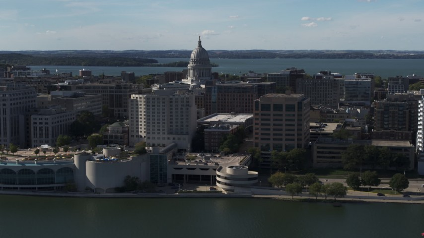 5.7K stock footage aerial video of the capitol seen from lakefront office buildings, Madison, Wisconsin Aerial Stock Footage | DX0002_160_004