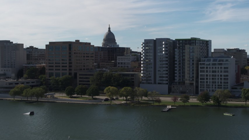 5.7K stock footage aerial video of the dome of the capitol seen from lakefront office and condo complexes, Madison, Wisconsin Aerial Stock Footage | DX0002_160_005