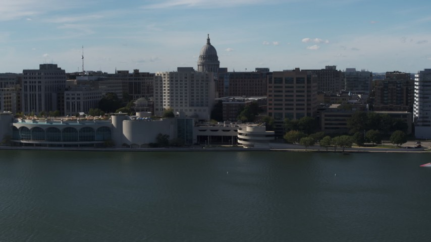 5.7K stock footage aerial video dome of the capitol seen while flying away from office buildings and convention center, Madison, Wisconsin Aerial Stock Footage | DX0002_160_006
